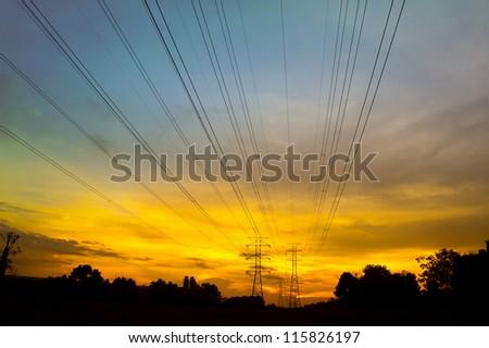 dramatic sunset via pylon tower - stock photo