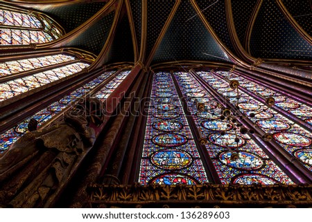 Dramatic view looking up at the stained glass and vaulted ceiling of St Chappelle Cathedral in Paris, France - stock photo