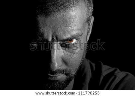 Dramatic view of a man face in darkness - stock photo