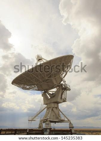 Dramatic view of backlit parabolic satellite dish at Very Large Array Radio Telescope near Socorro New Mexico - stock photo