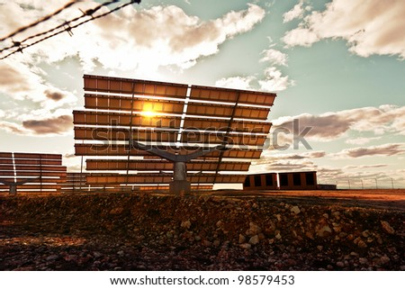 Dramatic View of Solar Panels at Sunset - stock photo
