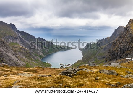 Dramatic view to mountains and fjord near Reine, Lofoten, Norway - stock photo