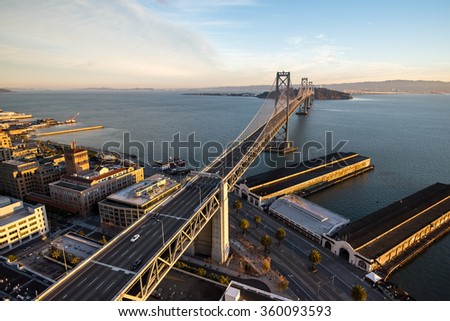 Dramatic wide-angle aerial view above the San-Francisco Oakland Bay Bridge on a brilliant winter morning - stock photo