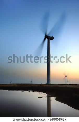 Dramatic wind turbine - stock photo