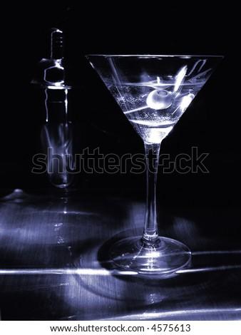 Dramatically lit martini in monotone blue. - stock photo