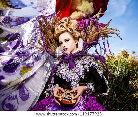 Dramatized image of sensual fashion girl - Art Fashion outdoor photo. - stock photo