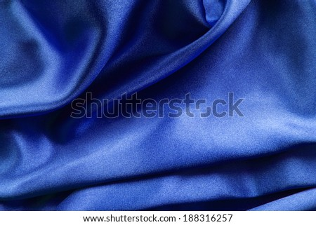 Draped deep blue silk as a background - stock photo