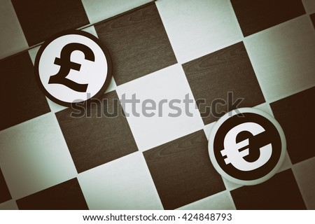 Draughts (Checkers) - British Pound vs Euro - comparison or conflict between economies of United Kingdom of Great Britain (UK) and Eurozone of European Union (underexposure, vignetting) - stock photo