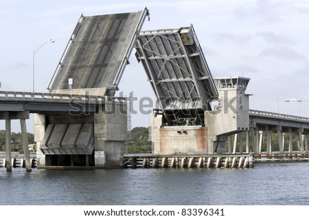 Draw bridge at gulf of Mexico in Florida opening for boat traffic - stock photo