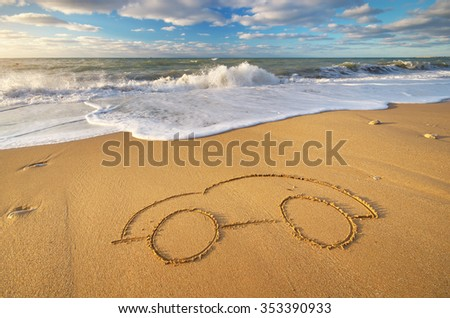 Draw car on beach sand. Conceptual design. - stock photo