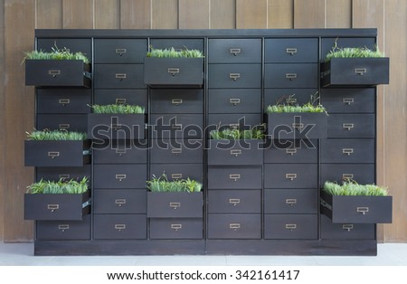 Drawers with blank tags in vintage furniture module - stock photo