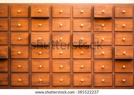 Drawers with blank tags in vintage furniture module. - stock photo