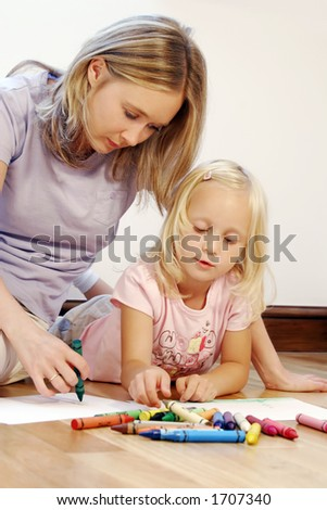 Drawing a picture together - stock photo