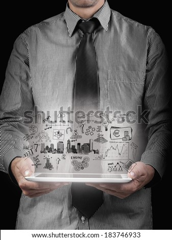 drawing business plan concept With Hand holding computer tablet pc - stock photo