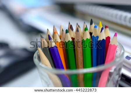 Drawing colorful pencils on the desk at the office - stock photo