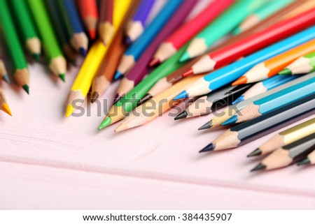 Drawing colourful pencils on a wooden background - stock photo