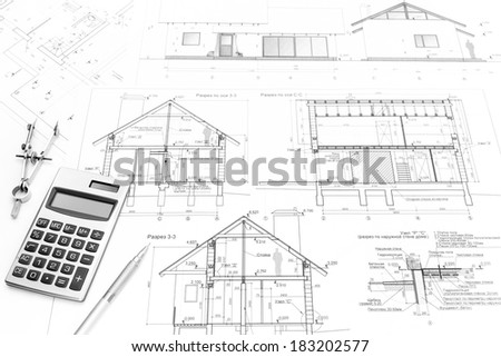 Drawing compass, calculator, pencil and architectural drawings of modern house - stock photo