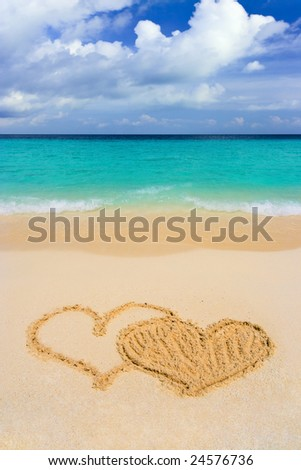 Drawing connected hearts on beach, love concept - stock photo