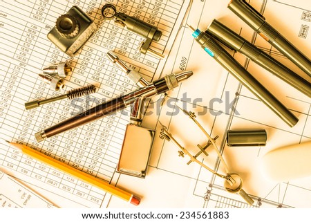 Drawing desk with tools for drawing. In yellow tone - stock photo