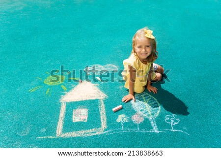 Drawing house with chalk - stock photo