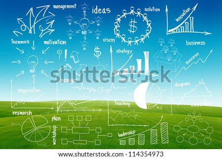 Drawing infographics elements graphics and diagrams, on blue sky and green grass background - stock photo