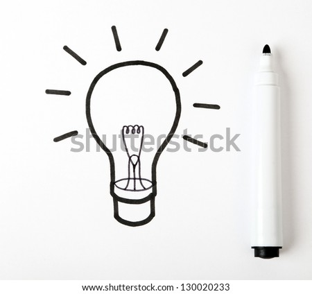 drawing light bulb on white paper - stock photo