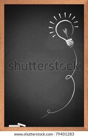 Drawing of a bulb idea on blackboard - stock photo