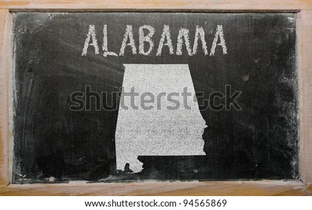 drawing of american state of alabama on chalkboard, drawn by chalk - stock photo