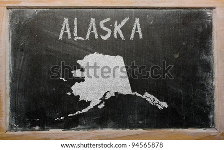 drawing of american state of alaska on chalkboard, drawn by chalk - stock photo