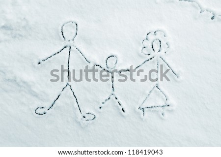 Drawing of family on snow - stock photo