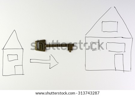 drawing of house with a arrow and key on a white background symbol of moving to an  another house with empty copy space - stock photo