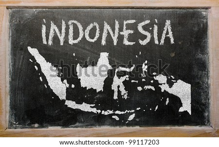drawing of indonesia on blackboard, drawn by chalk - stock photo