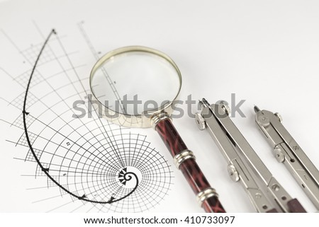 drawing of the golden section, magnifying glass & compass - stock photo