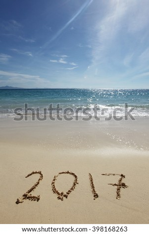 Drawing 2017 on the sand of a tropical beach - stock photo