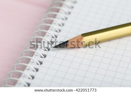 Drawing pencil with notebook on a wooden background - stock photo