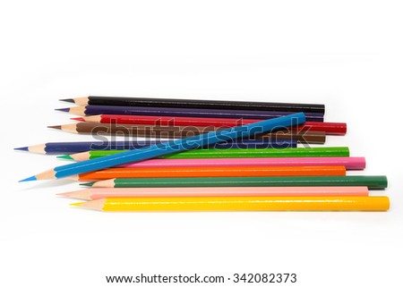 Drawing supplies: height light blue color pencil on colorful pencils, isolated on white background  - stock photo