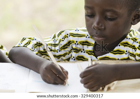 Drawing Writing Activity: Handsome black African ethnicity school boy learning to draw and write with a big colored pencil. Educational symbol background. - stock photo