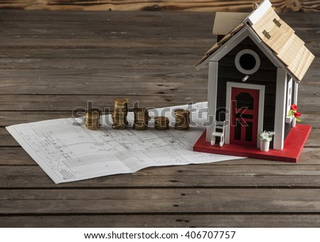 Drawings for building  and small wooden house - stock photo