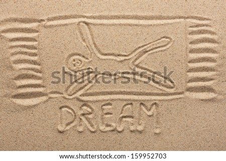 Drawn man on the sand, conceptual image - stock photo