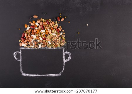 Drawn pot and real pulses on the chalkboard with copy-space - stock photo