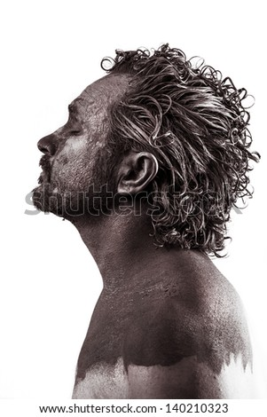 Dream, Anger, Dreaming, man covered in mud, naked, in profile, dirty skin - stock photo