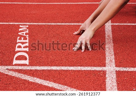 Dream - hands on starting line - stock photo