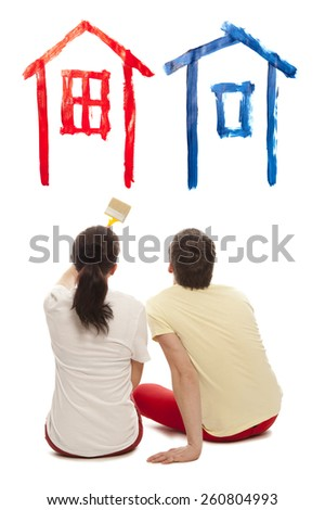 Dream house. Young caucausian couple with paint brushes together. Isolated on white background - stock photo