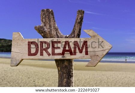 Dream wooden sign with a beach on background - stock photo