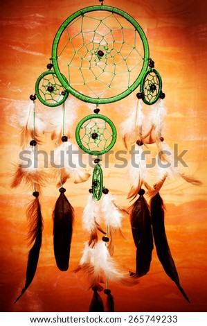 dreamcatcher against a red background - stock photo