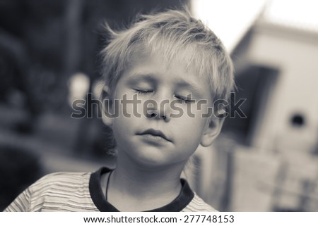 """Dreamer. Beautiful boy, 6 years old, his eyes closed, tinted photo. """"like young Putin))"""" - stock photo"""