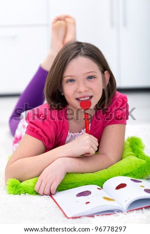 Dreaming about first love - young girl and her diary - stock photo