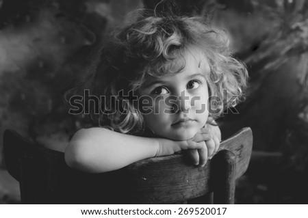 Dreaming beautiful little girl, monochrome portrait - stock photo
