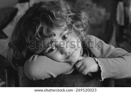 Dreaming beautiful little girl, monochrome portrait - stock photo