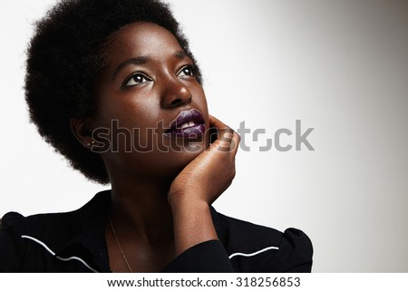 dreaming black woman - stock photo